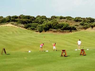 wide driving range and well developed practice area at the bay course