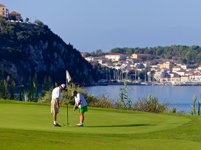 a green on the bay course of Costa Navarino with on the background the village of Pylos